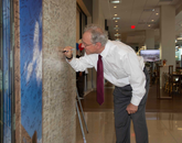 "Tucson Mayor Jonathan Rothschild signs a ""memory wall"" in Tower 1 during the grand opening reception on April 11. (Photo: Joe Ramirez/Area 520)"