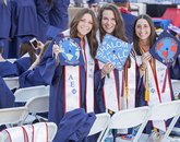 Arts, media and entertainment major Annie Polachek was with Rachel Altfeld and Jessica Granick, both family studies and human development graduates, as they brandished their decorated mortarboards.