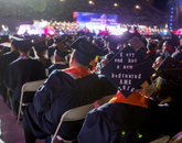 A decorated mortarboard carried a keen message.