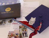 In preparation for the virtual ceremony, thousands of graduates opted to receive kits that included mortarboards, tassels and a diploma cover or a notepad and pen, along with a note from the president and provost congratulating graduates on their accomplishments. (Photo: Chris Richards/University of Arizona)