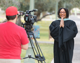 Kendal Washington White, dean of students and vice provost for campus life, poses with the university's ceremonial mace during filming for the virtual 2020 Commencement. (Photo: Chris Richards/University of Arizona)