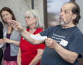 Jose Quintero, English teacher at Villa Oasis High School in Eloy, Arizona, and one of the presenters at the Teacher Training Workshop, trades insulting greetings with other participants at the workshop.