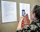 Nicki Navarro, an English teacher from Sahuarita High School, photographs a chronology of milestones in William Shakespeare's life. The timeline is part of the Shakespeare and Elizebathan Culture exhibit at UA Library Special Collections that will be on display until July.