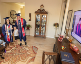 Lauren Easter, this year's Provost Award winner, celebrates with her partner and fellow graduate Zachary Stout, along with Easter's son and parents. (Photo: Chris Richards/University of Arizona)
