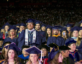 Professional and graduate students rise to be conferred degrees by UA President Robert C. Robbins. (Photo: John de Dios/UANews)