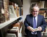"Rare books archivist Roger Myers helped curate ""Shakespeare's Contemporaries and Elizabethan Culture,"" which includes historical snapshots with documents that shaped Shakespeare's culture, such as anti-theatrical polemics, scientific discoveries and political activities. (Photo credit: John de Dios/UANews)"