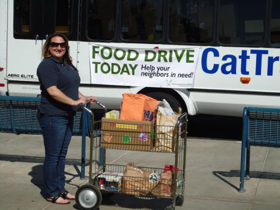 A UA4Food ambassador wheels donations to the Cat Tran.