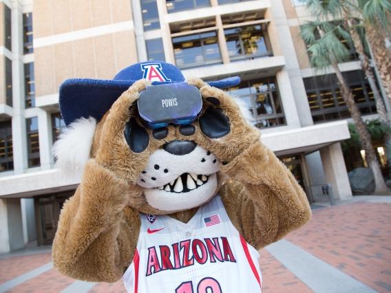 UArizona mascot Wilbur Wildcat looks through a virtual reality headset