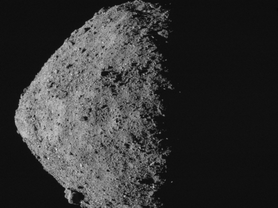 This image, showing asteroid Bennu's spinning-top shape, was taken by the MapCam camera on NASA's OSIRIS-REx spacecraft on April 29, from a distance of 5 miles. From the spacecraft's vantage point, half of Bennu is sunlit and half is in shadow.  Credit: