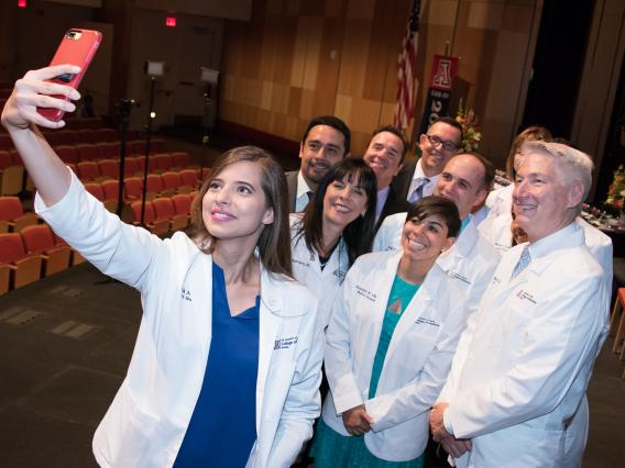 Even the new dean, Dr. Guy Reed , joined in on Zainab Khan's selfie at Friday's White Coat Ceremony at the UA College of Medicine – Phoenix.
