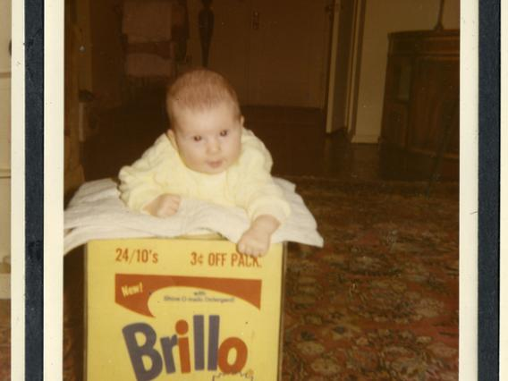 "Baby Lisanne Skyler and the Brillo Box from ""Brillo Box ."" From the Andy Warhol Foundation for the Visual Arts Inc."