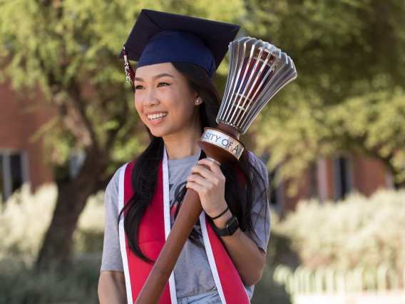 Student carrying graduation mace