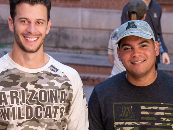 Student veterans John Krause and Manny Alberto Matias modeled Operation Hat Trick merchandise to support military service members and veterans.