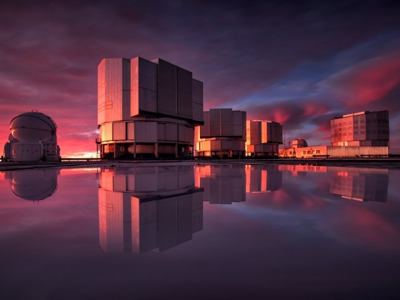 The Very Large Telescope pictured at sunset. VLT's instrumentation was adapted to conduct a search for planets in the Alpha Centauri system as part of the Breakthrough initiatives.