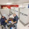 two men working on freezer installation