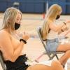 two female students self-administer nasal swab tests