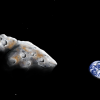 An asteroid in space with Earth in the background