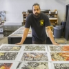 aaron coleman with several prints