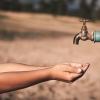 Hands under a spigot