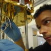 Scientist working on an experimental setup as part of the Center for Quantum Networking