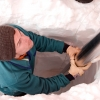 Matthew Osman steadies an ice core drilling barrel into the Greenland Ice Sheet snow surface