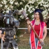 Jaesa Strong, a senior graduating with a degree in pharmacy, poses with the university's ceremonial mace during filming for the virtual 2020 Commencement.