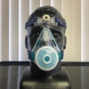 In response to a shortage of masks, researchers is working to design, 3D print and test masks for health care workers. Pictured is a mask prototype, fitted on a mannequin.
