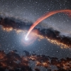 Illustration of a black hole shredding a star in a tidal disruption event