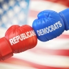"a red boxing glove that says ""Republican"" and a blue boxing glove that says ""Democrat"""
