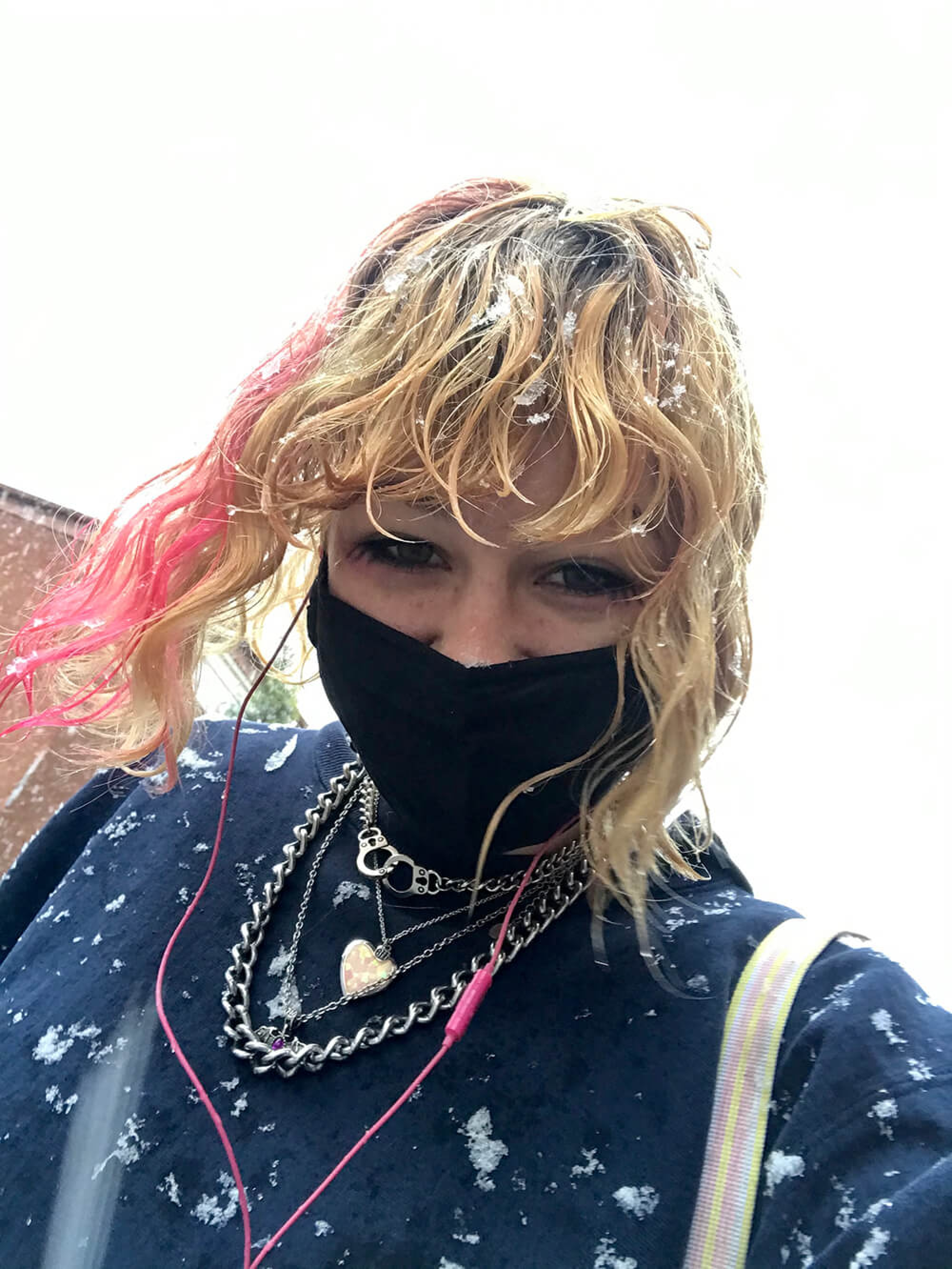 woman wearing a mask standing in the snow