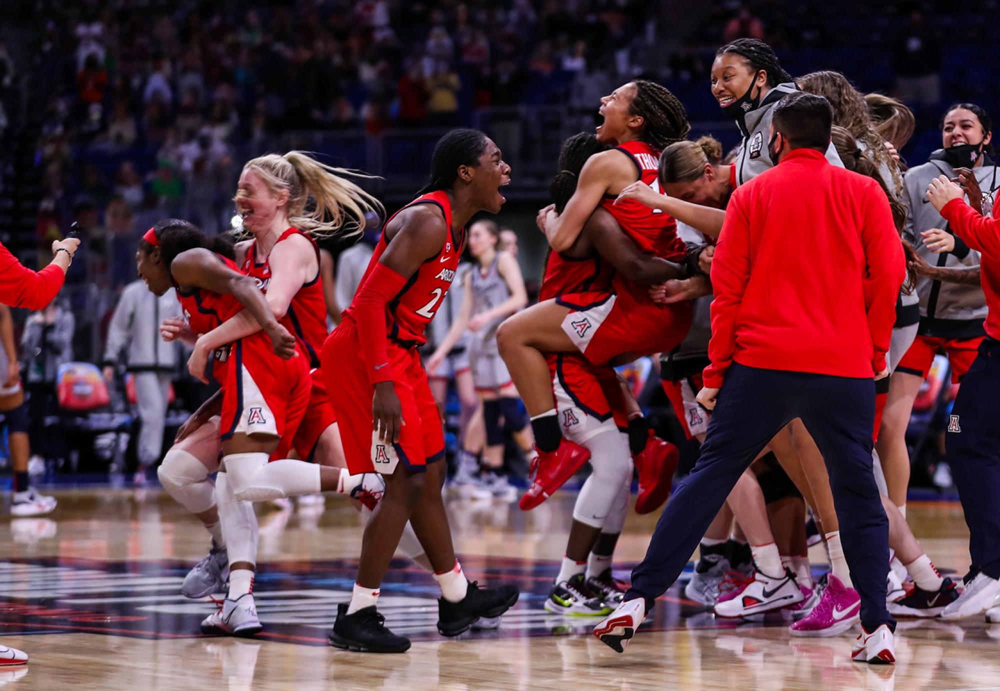 basketball players celebrating