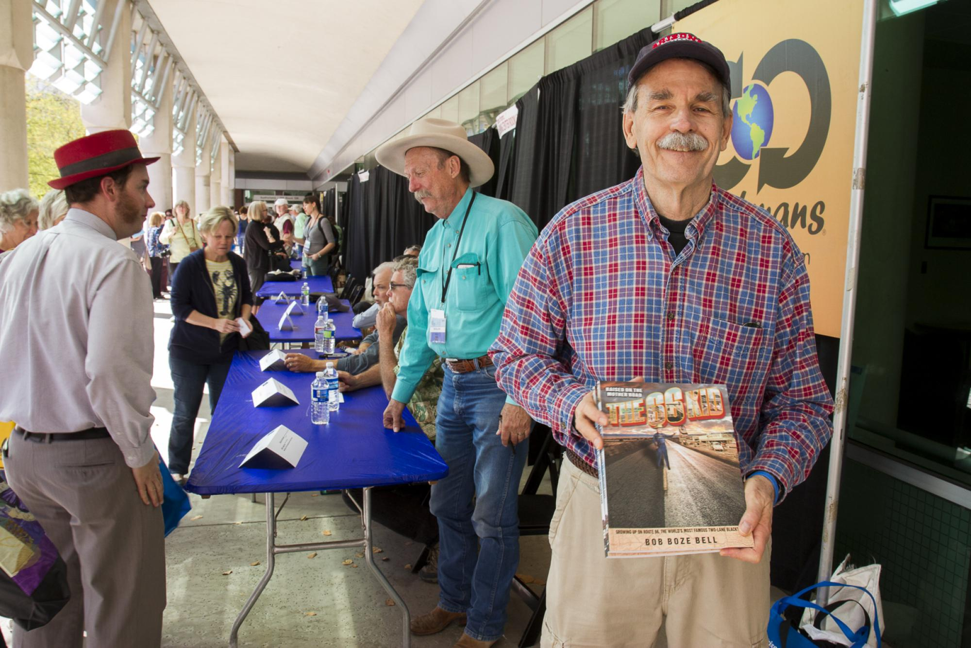 """Author Bob """"Boze"""" Bell  and Russ Luke at the Integrated Learning Center author signing area. While seeking Bell's autograph, Luke discovered they had grown up in the same town of Kingman, Arizona."""