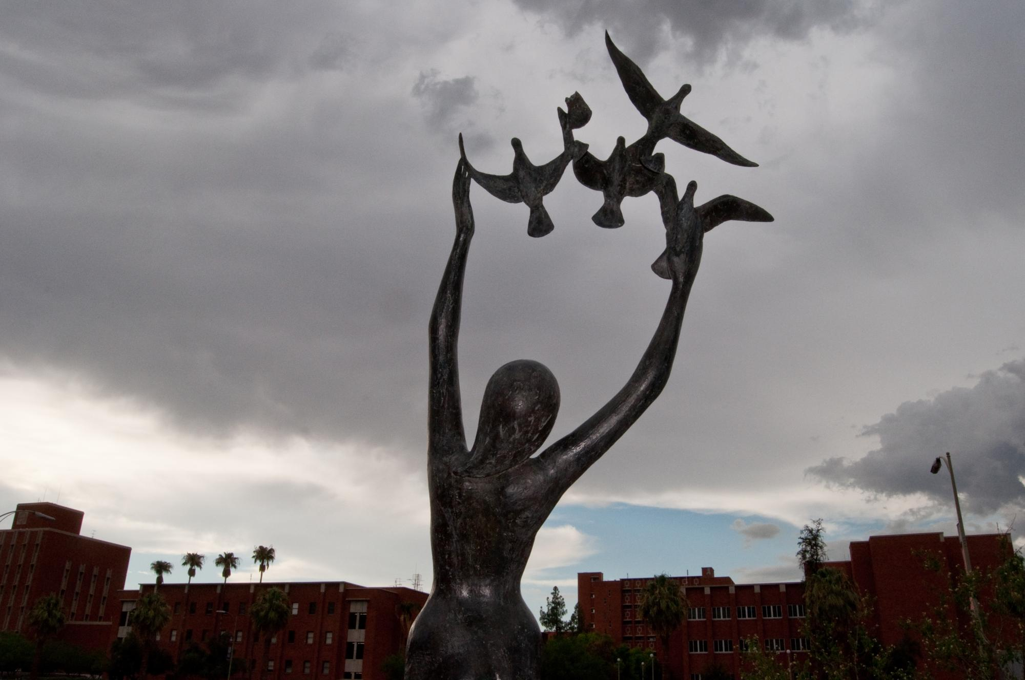 """David Wynne's bronze sculpture, """"Girl With Doves,"""" is near the entrance to the Main Library."""