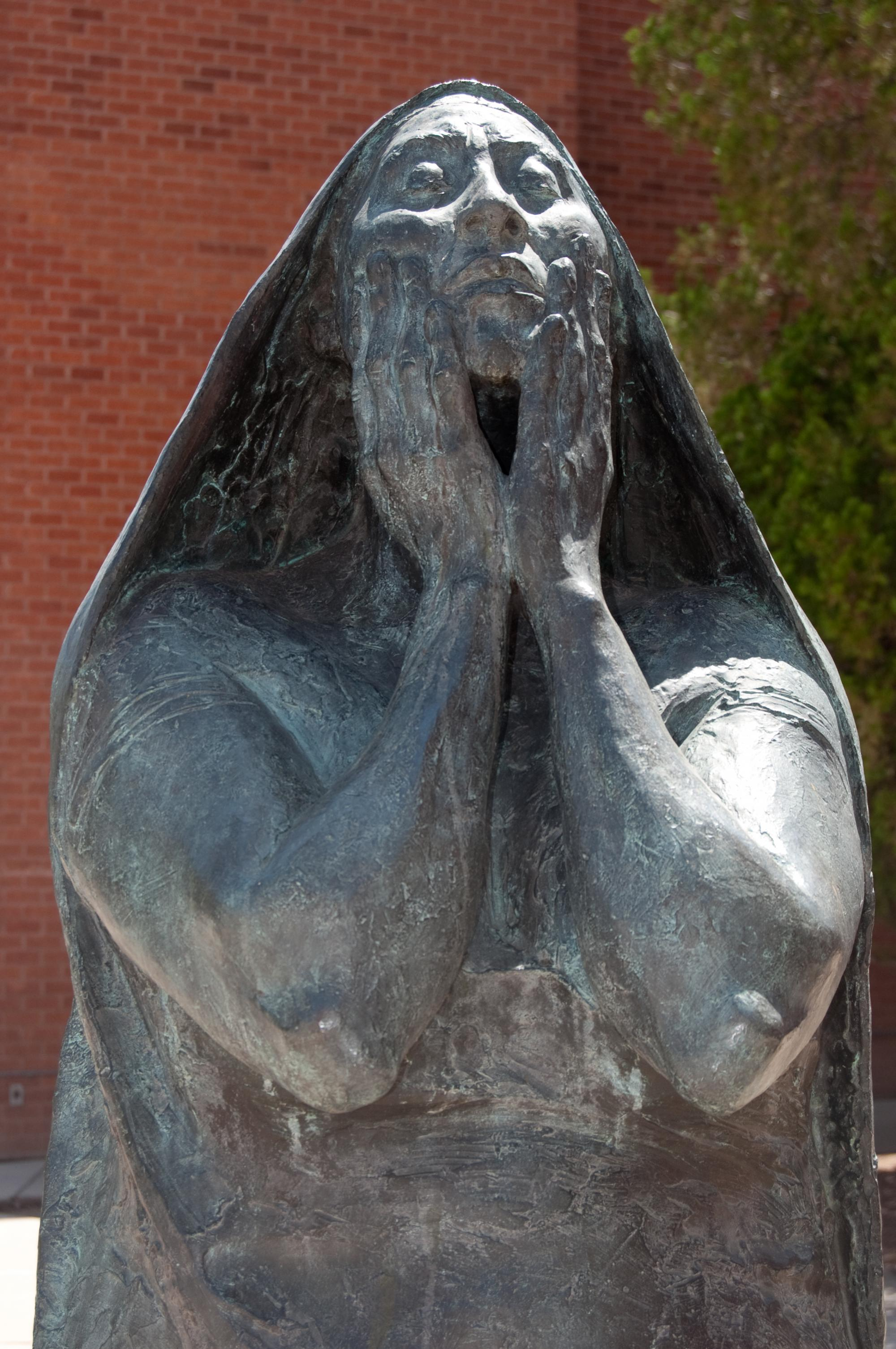 """""""Standing Woman With Hands on Her Face """" by Francisco Zúñiga, who was an internationally acclaimed sculptor and printmaker, is in front of the UA Museum of Art and the School of Art. The sculpture depicts an indigenous woman from Central America."""