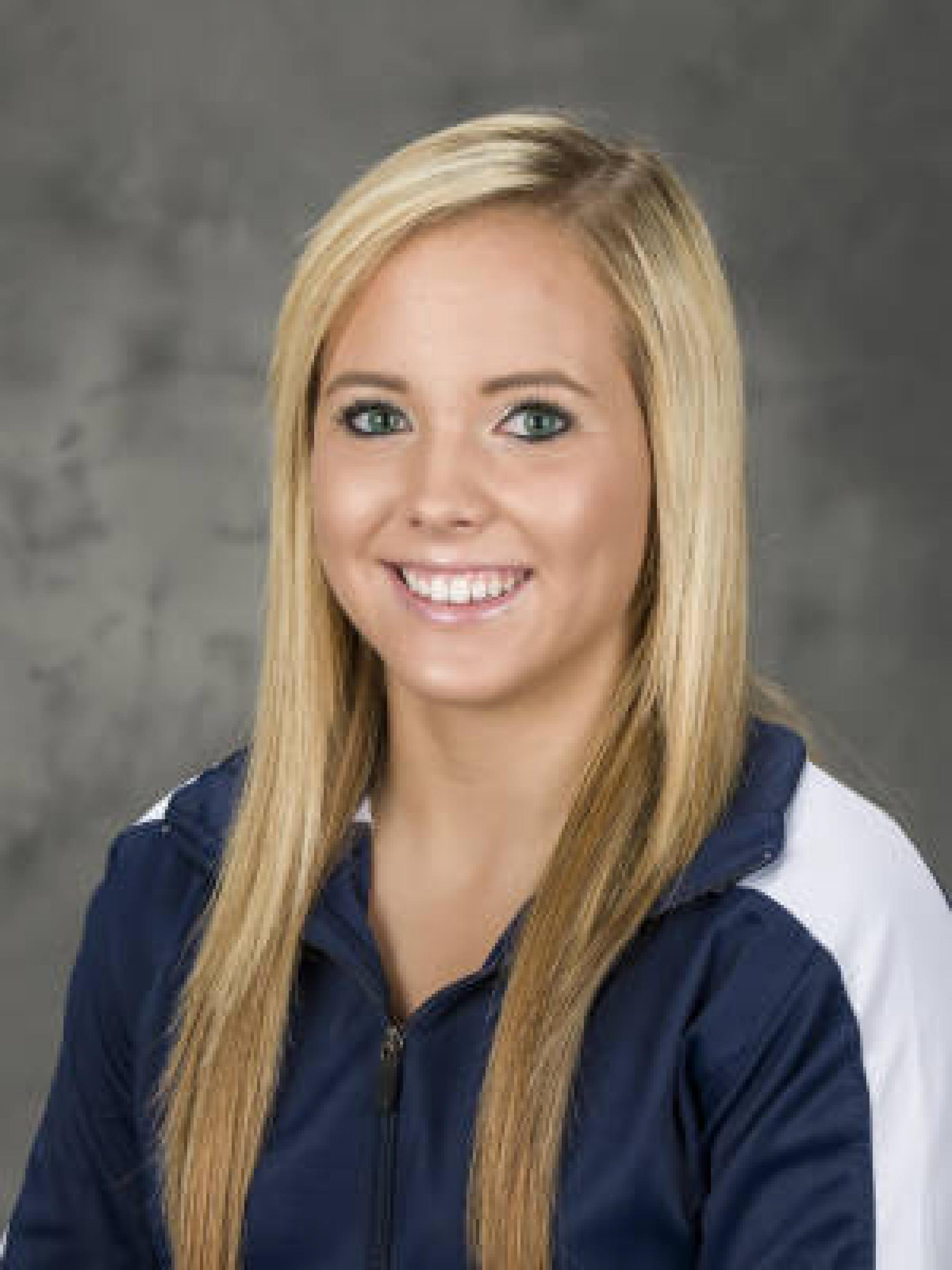 """Sophomore Gabby Laub says the uneven bars is her favorite event. """"It was my first event in club gymnastics and since I've started college it's been really fun for me."""""""