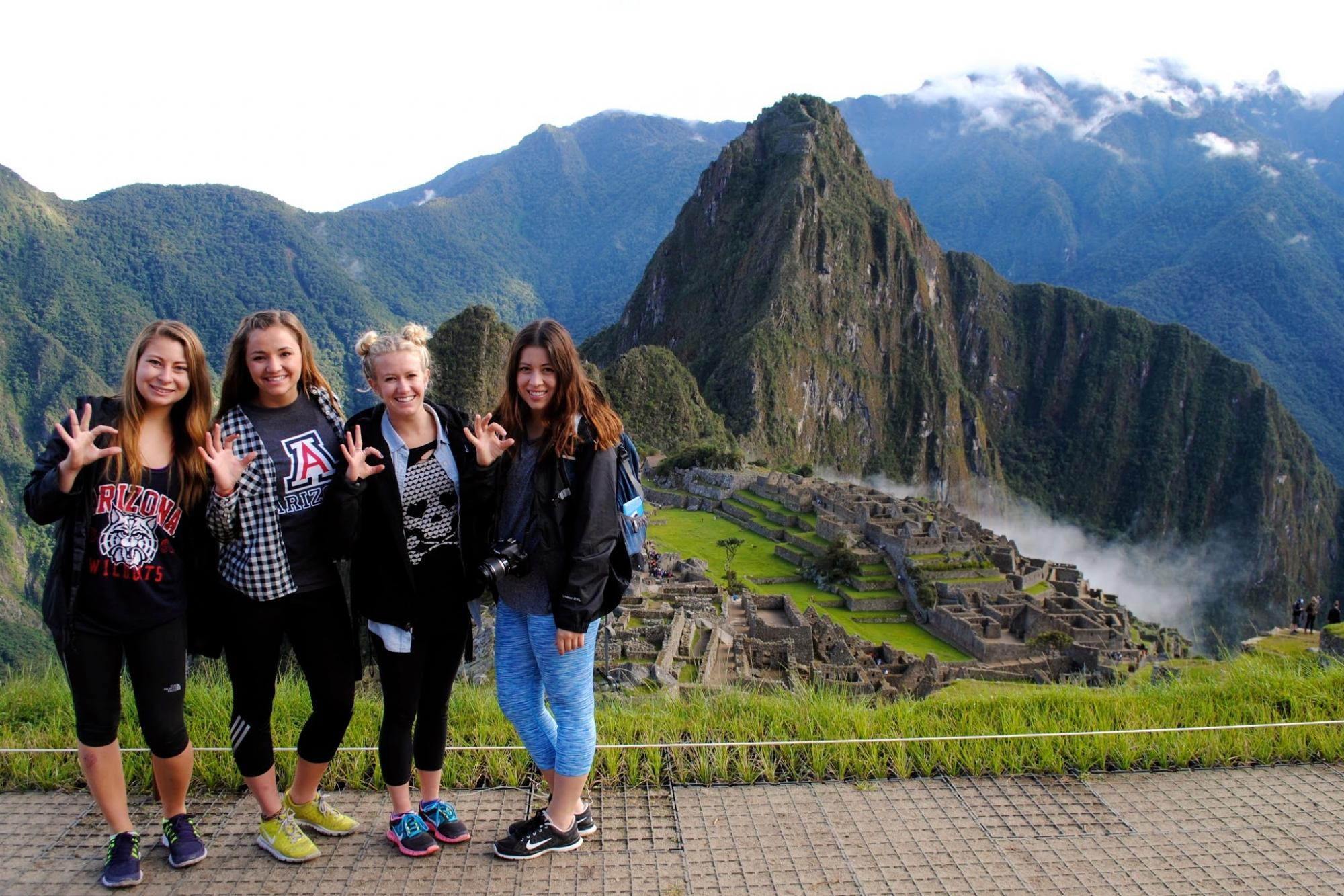 Alumna Kaitlin Corell, who earned a degree in global studies, took a photo with friends at Machu Picchu in Peru.