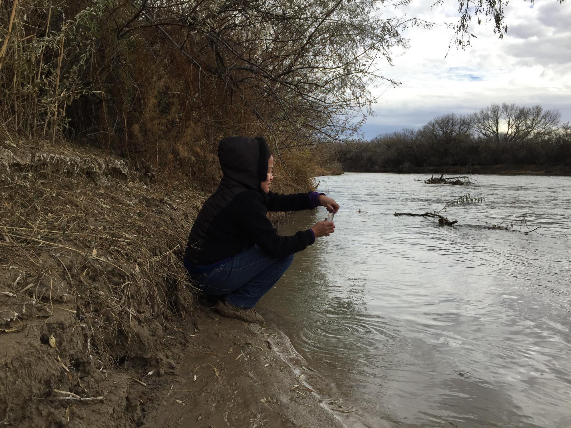 Karletta Chief samples San Juan river water.