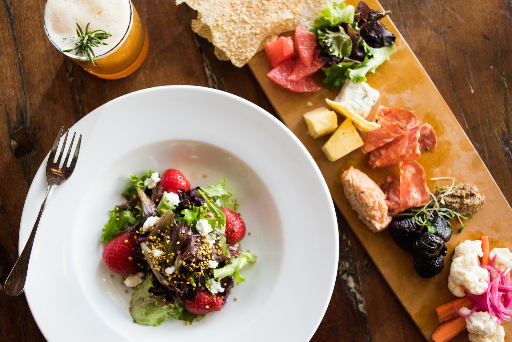 Proper's upscale menu features fresh food, often from local and regional sources.