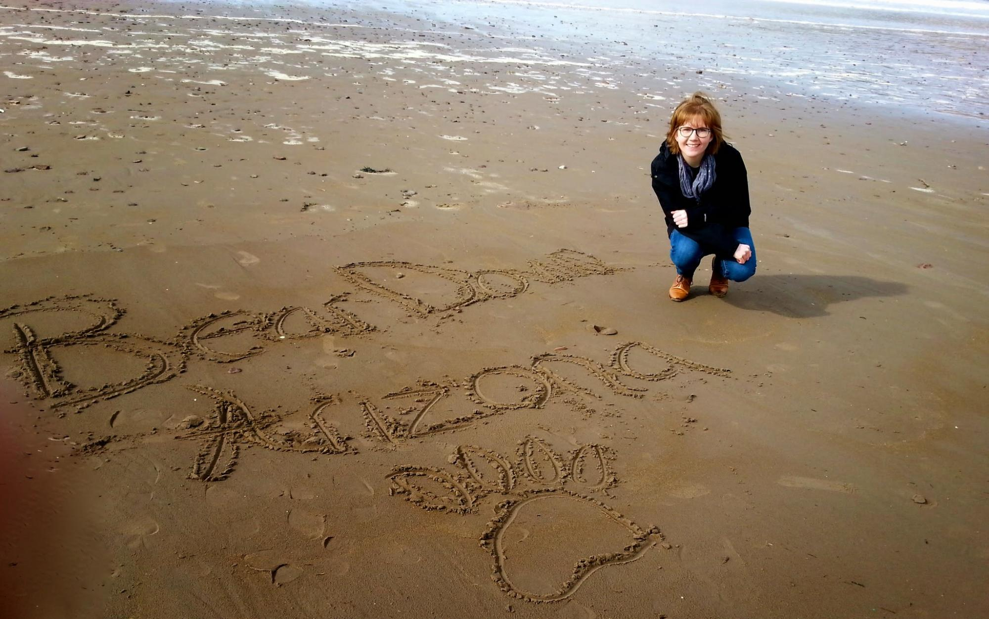 Katlyn Campbel, who graduated in 2015 with a degree in public health, poses on Inch Beach in County Kerry, Ireland.