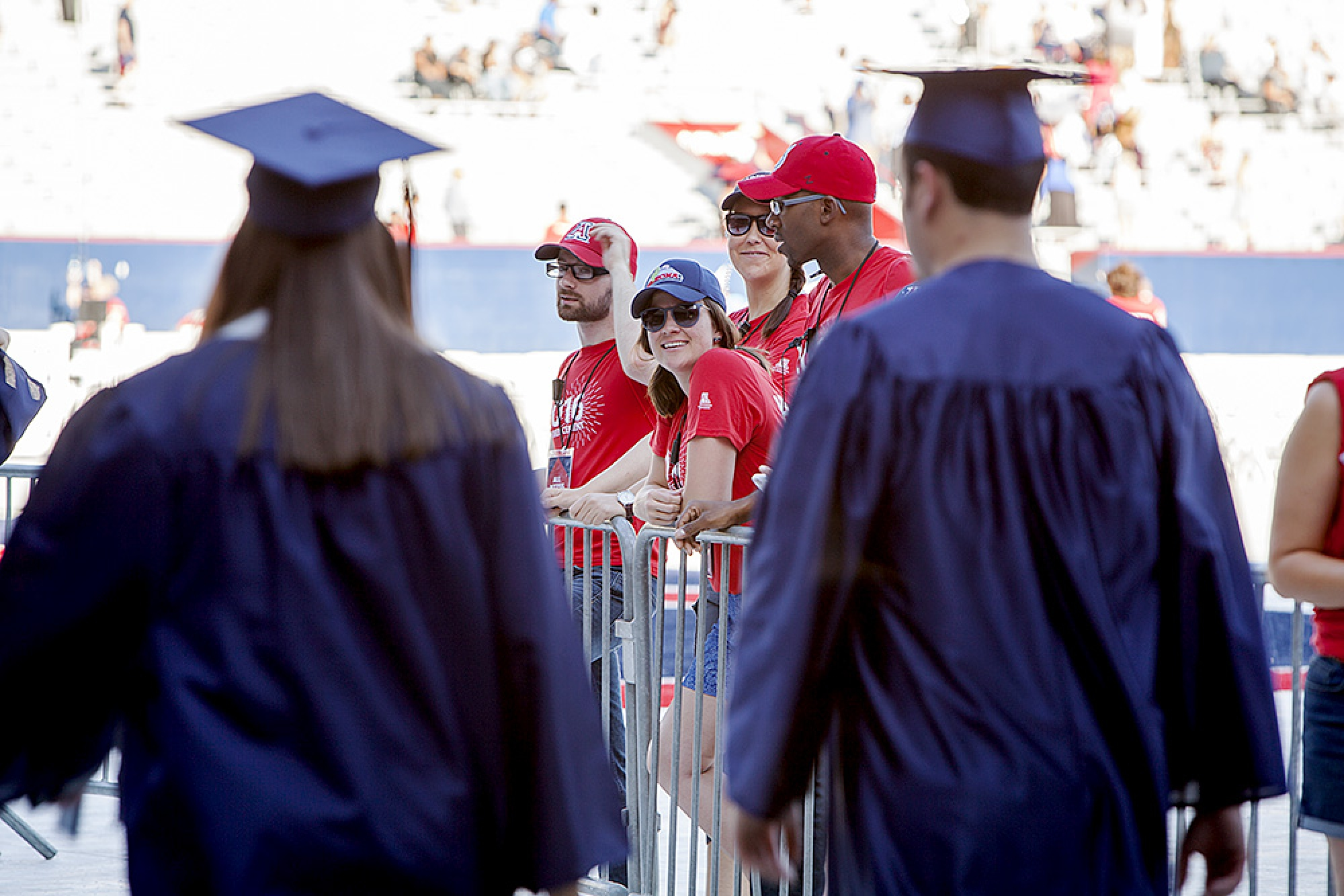 More than 300 volunteers worked Commencement, including these who greeted students as they entered the stadium.