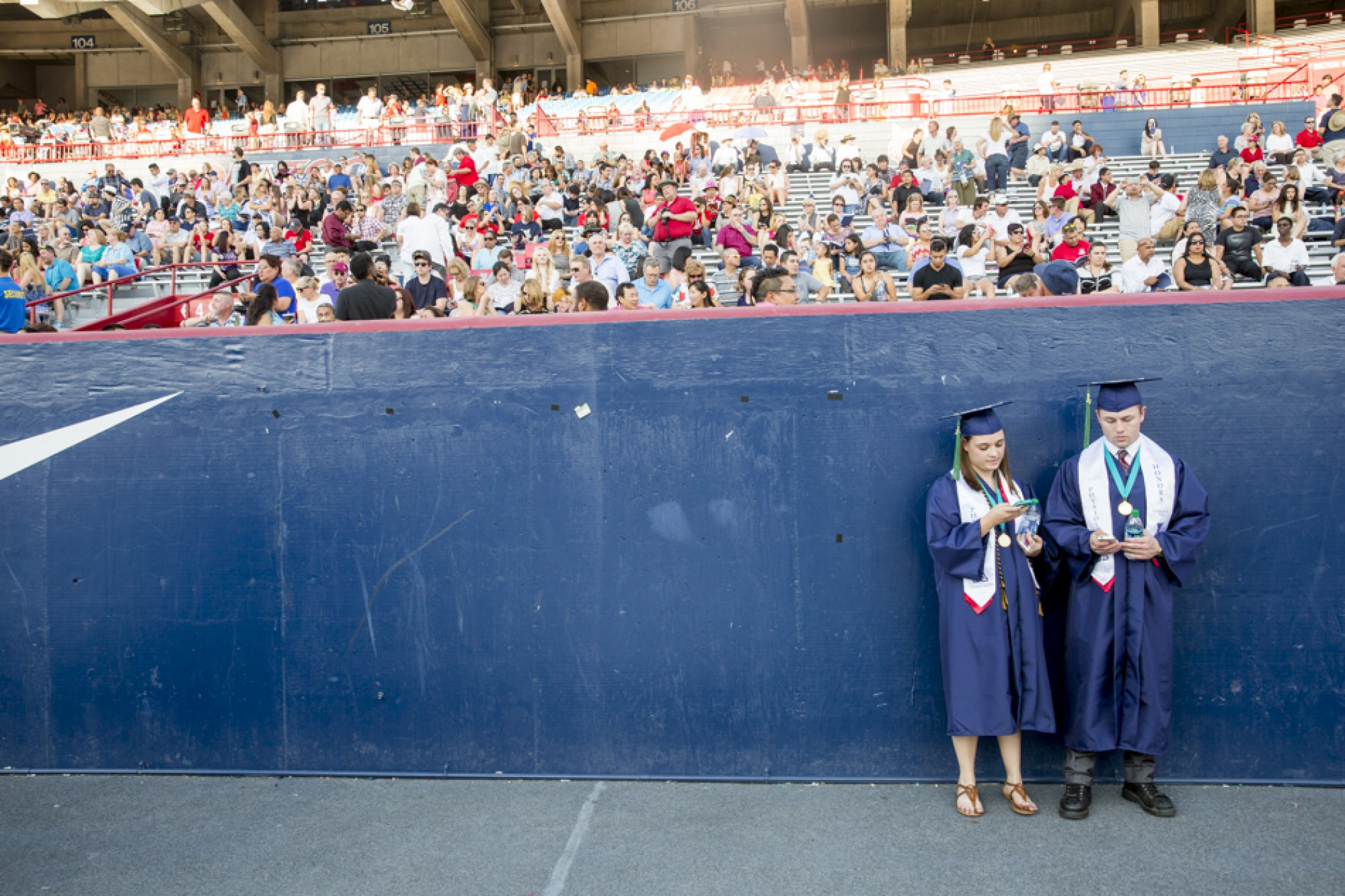 Physioiogy graduates Kayla Darris and Daniel Kitts waited for their friends to arrive.