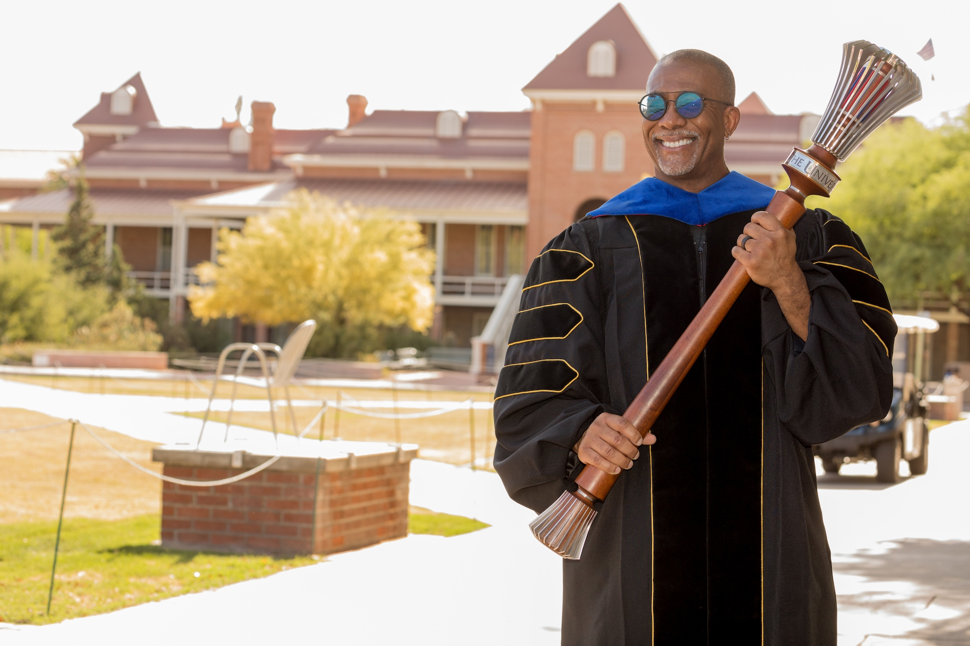Bryan Carter, associate professor of Africana studies and director of the UArizona Center for Digital Humanities, poses with the university's ceremonial mace during filming for the virtual 2020 Commencement.