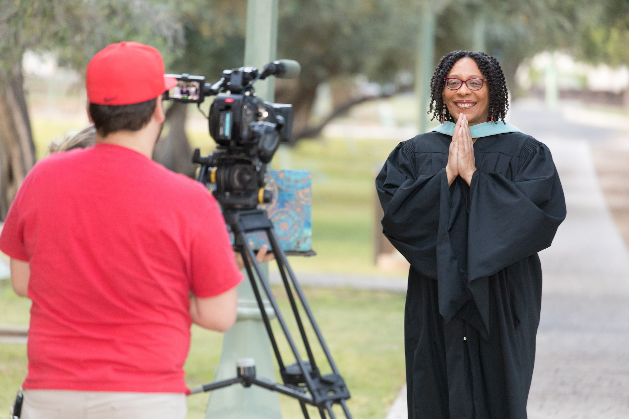 Kendal Washington White, dean of students and vice provost for campus life, poses with the university's ceremonial mace during filming for the virtual 2020 Commencement.