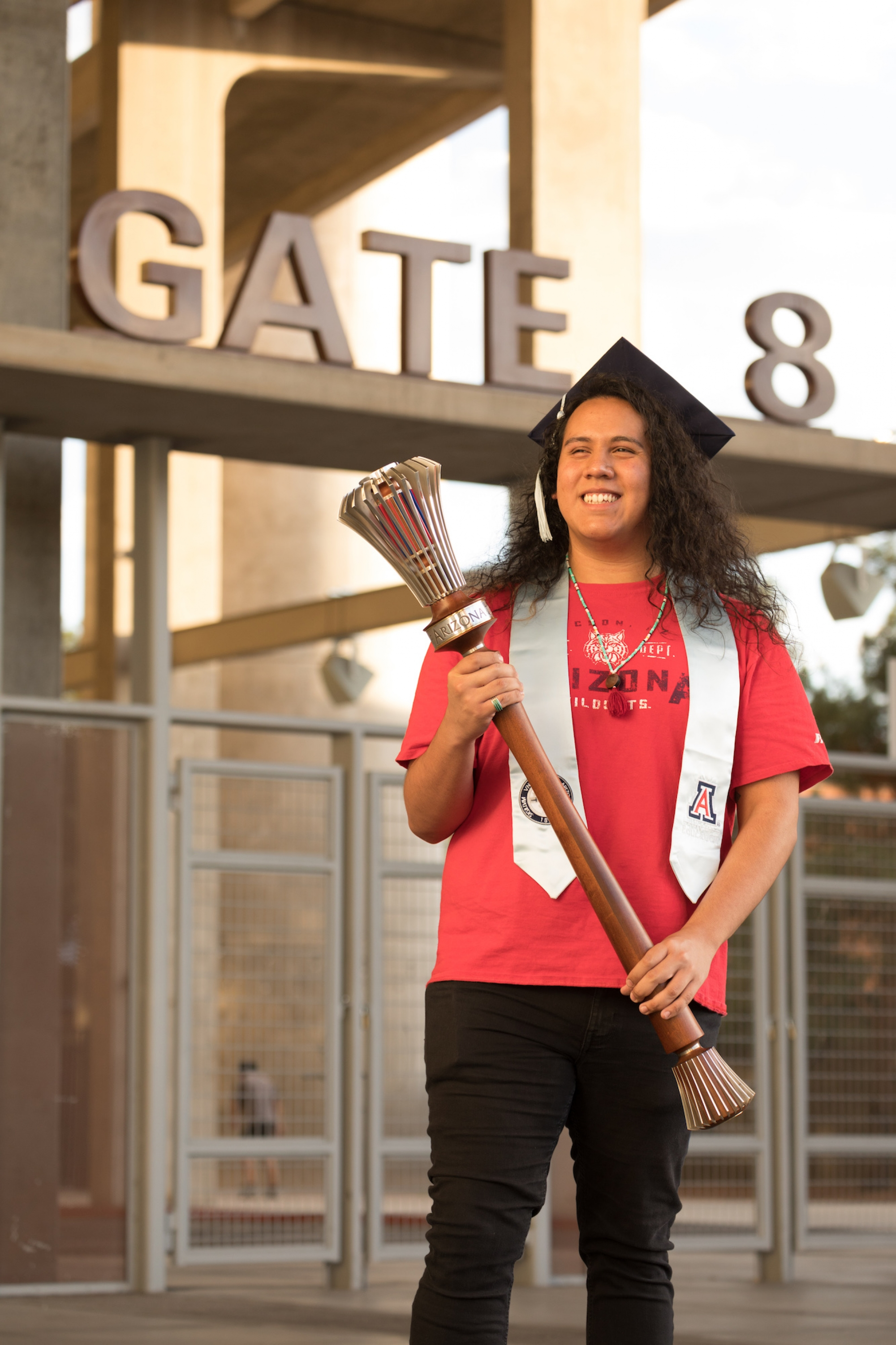 Tony Viola IV, a senior graduating with a degree in literacy, learning and leadership, poses with the university's ceremonial mace during filming for the virtual 2020 Commencement. Viola is one of this year's Robie Gold Medal recipients.
