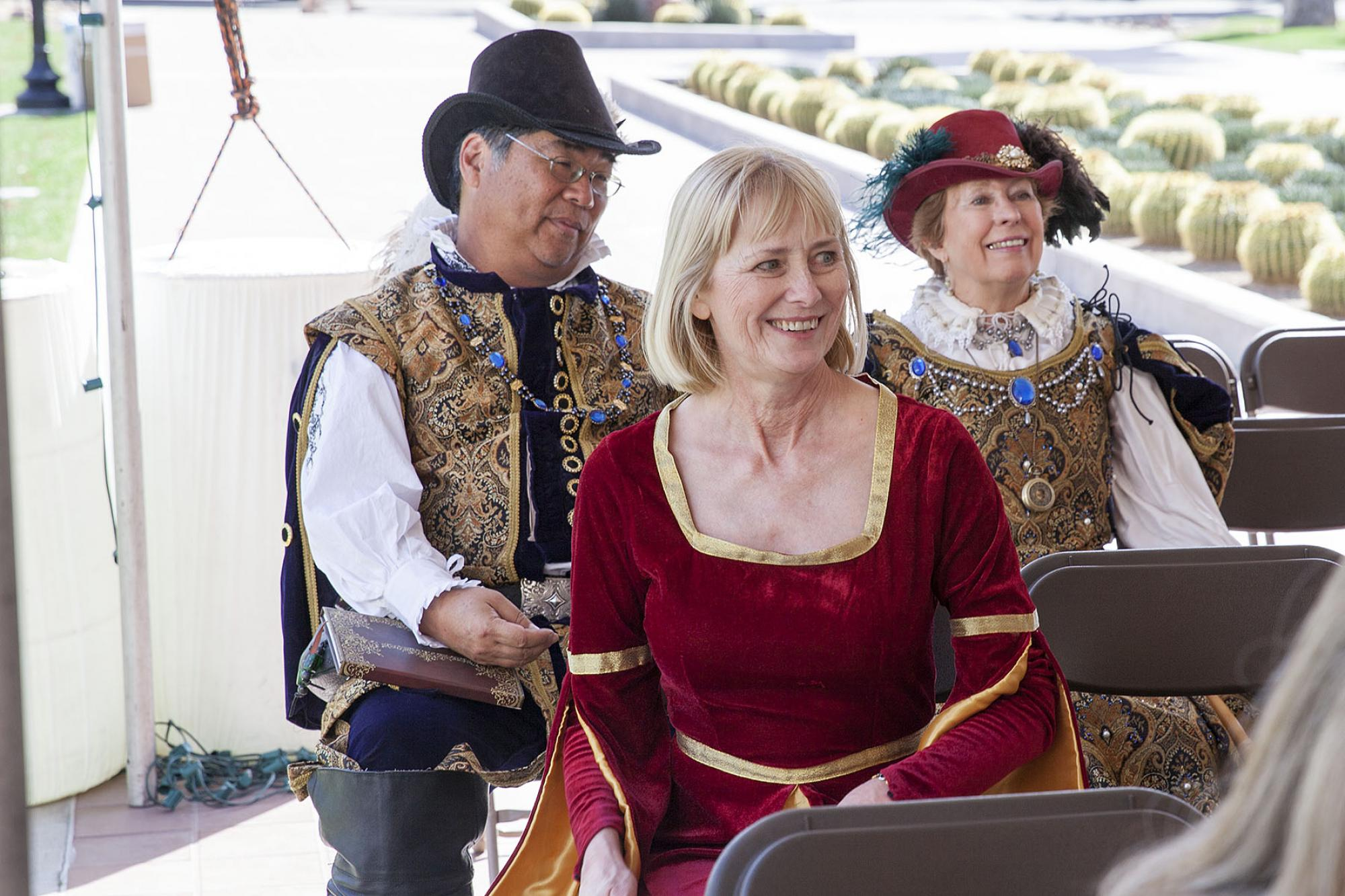 Jane Prescott-Smith, special assistant to the dean with University Libraries and one of those who helped get the First Folio to the UA, sits with members of the Renaissance Festival, who later led workshops on improv comedy, sing-along songs and Shakespea