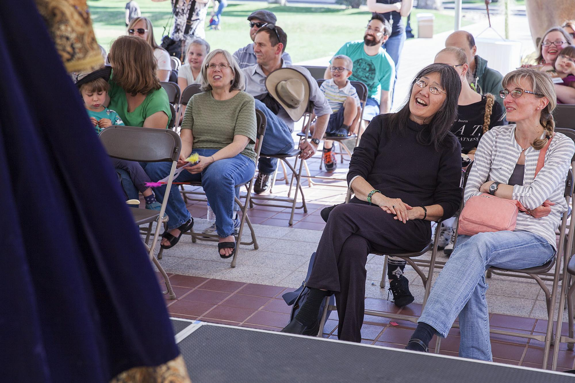 Carolyn Classen, website editor for the Southern Arizona Japanese Cultural Coalition, and her friend Stefanie Stine serve as judges during the Renaissance Festival Improv game session at Saturday With Shakespeare at the Arizona State Museum.