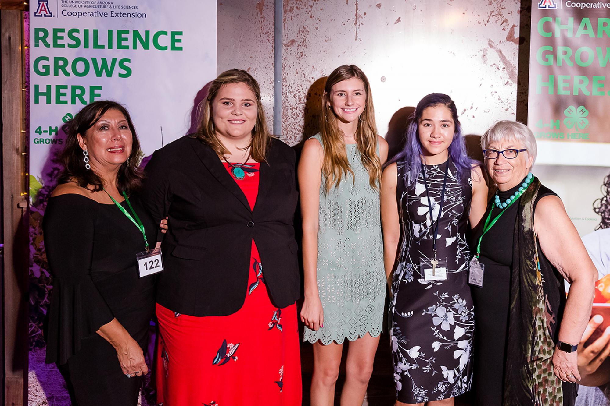 From left: 4-H Foundation Board Member Juanita Waits, scholarship recipients Elizabeth McGibbon, Autumn Gilbert and Robin Lee, and 4-H Foundation President Julie Adamcin.