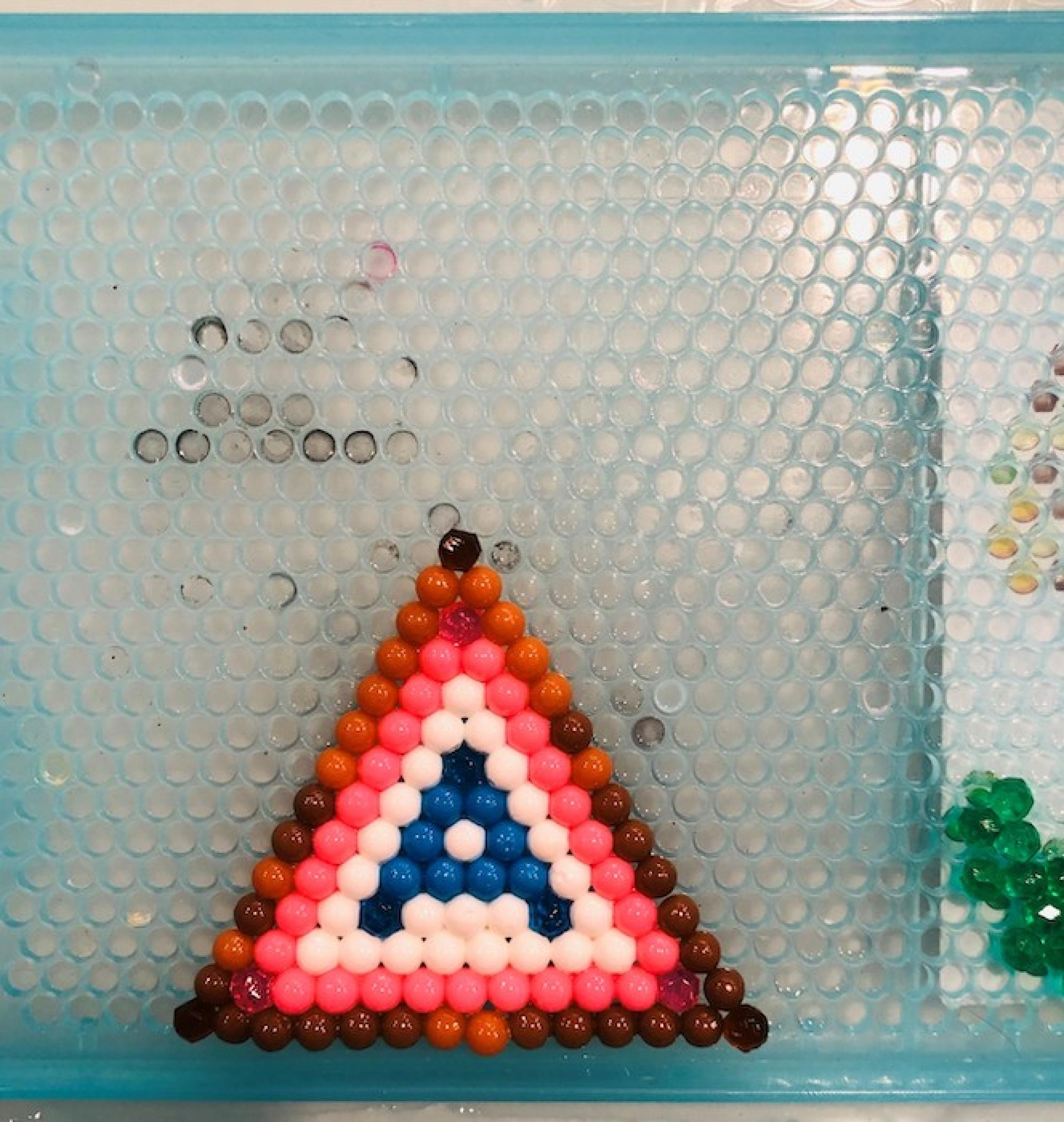 """While their UA-employed parents now both work from home, my two sons are keeping themselves entertained and celebrating their Wildcat spirit: The 6-year-old is making A Mountains out of Aquabeads and the 4-year-old is handing out """"tickets to Arizona baseb"""