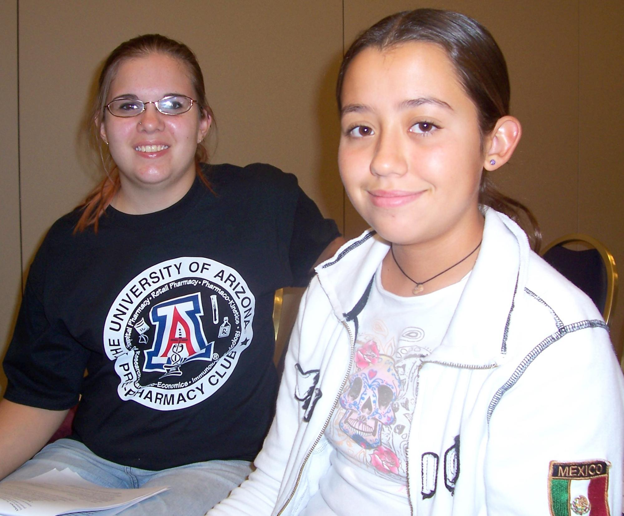 Though new to one another, UA student Cassandra Anderson and middle school student Isabella Gonzalez-Potter immediately began talking about school and science after meeting Saturday afternoon.