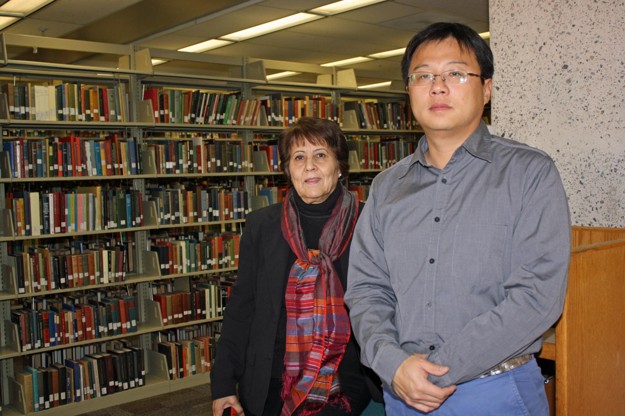 UA librarians Atifa R. Rawan and Yan Han have worked closely on the preservation project, at times traveling to Afghanistan to work directly with their collaborators.